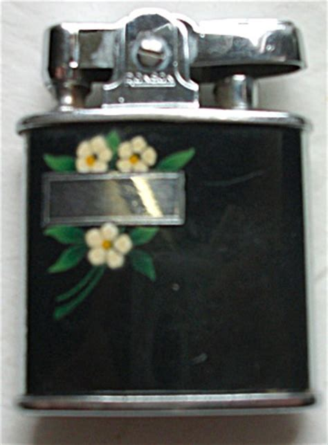 29 Lighters On Dresser by Vintage Ronson Princess Floral Black Enamel Lighter
