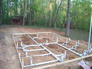 the slab plumbing for a new bath house at c
