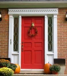 red front door with pineapple knocker
