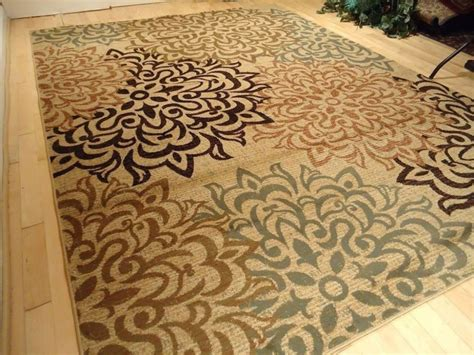 create cozy room ambience with area rugs idesignarch use area rugs to create cozy ambience home decorator shop