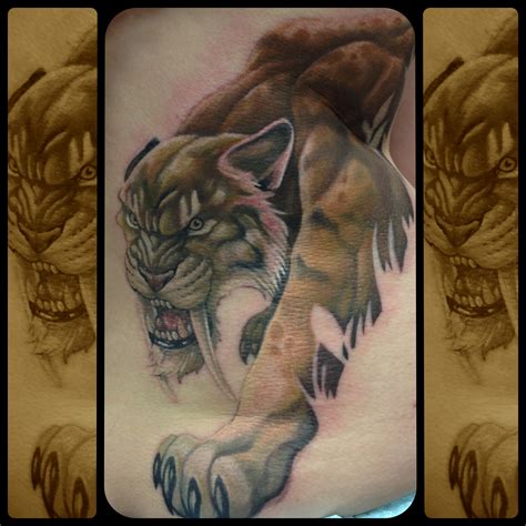 saber tooth tiger tattoo saber tooth karn animal tattoos