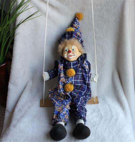 swing dolls porcelain circus clown doll on hanging wood swing vintage