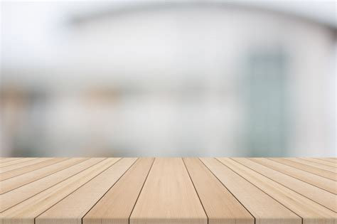 product background wood table top on white blurred background from building