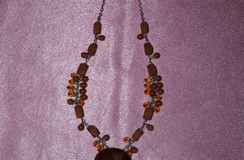 Kalung Kepang Mutiara Coklat aurel koleksi kalung dari aurel batu akik sulaiman coklat