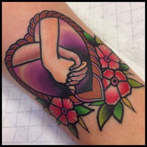 tattoo hand cs 1 6 gentle hands holding a heart tattoo pictures to pin on