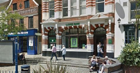 lloyds bank woking in straw hat robs reigate bank with suspected firearm