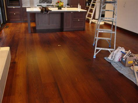 Distressed Hardwood Flooring In Kitchens - wide plank wood flooring for kitchen after remodel