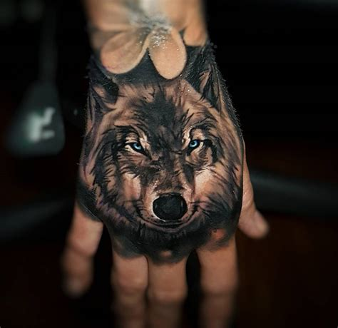 wolf hand tattoo evil wolf on best design ideas