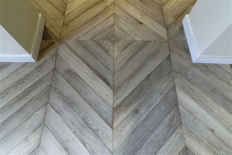 chevron floor tile atelier des granges french parquet in the entry