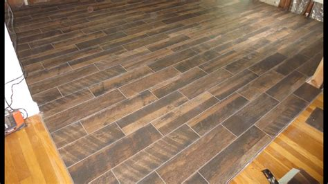 caretaker in floor system picture installed wood look plank tile installation time lapse on schluter