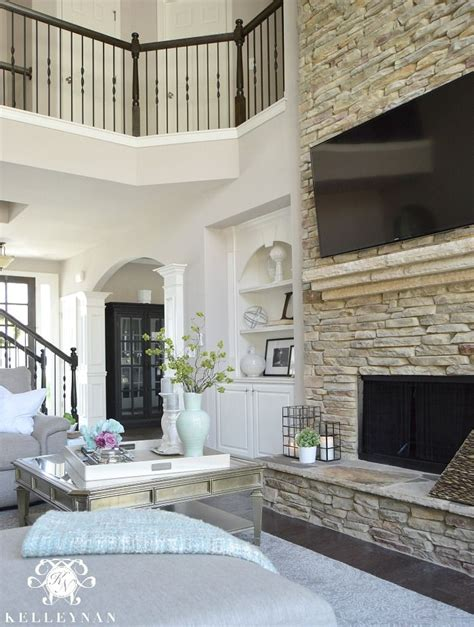 two story fireplace two story living room with stacked stone fireplace and