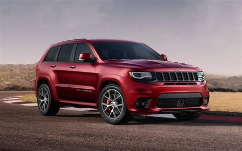pink jeep grand cherokee comparison jeep grand cherokee srt 2017 vs porsche