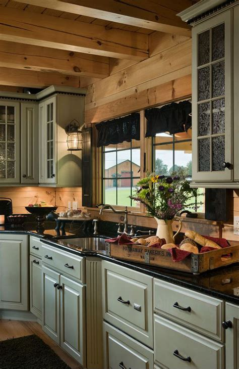 rustic green kitchen cabinets 1000 ideas about log cabin kitchens on pinterest cabin