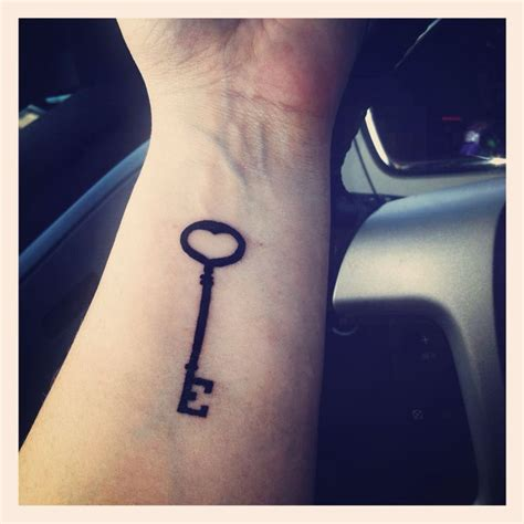 minimalist key tattoo skeleton key tattoo with e for emmett inked pinterest