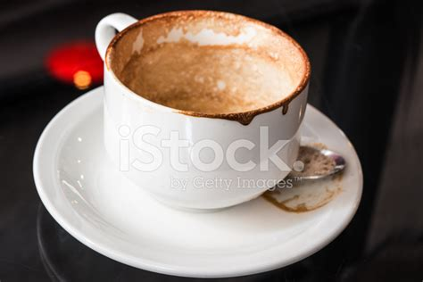 Mug Single Empty empty used coffee mug with stains on glass table stock