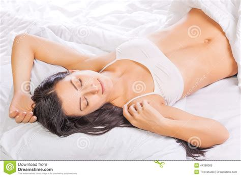 girl in bed pretty young woman is sleeping in bed stock photo image