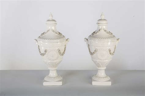 white ceramic urn pair of italian white ceramic urn vases at 1stdibs