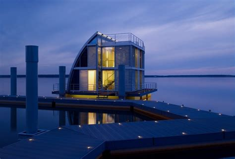 modern and unique floating house with sail like shape ar
