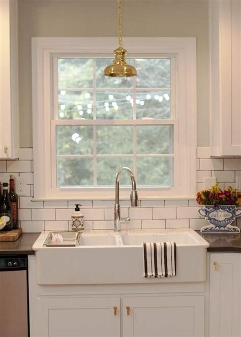 pendant light over kitchen sink source the every girl jessie epley kitchen features