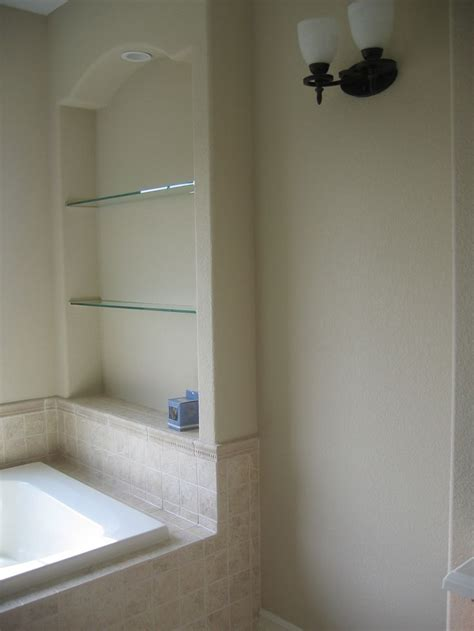 shelf over bathtub built in nook in the drywall adds shelves for above the
