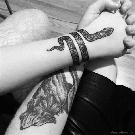 55 top class snake tattoos for arm
