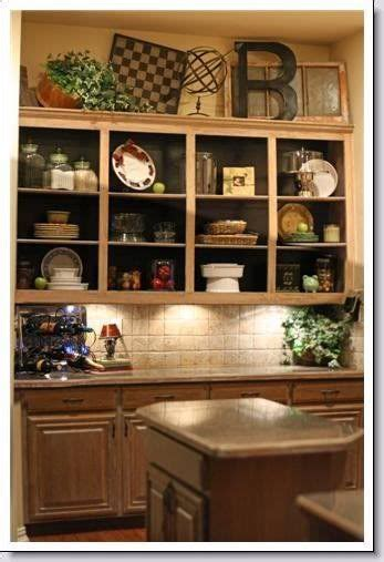 top of kitchen cabinet decorating ideas 25 best ideas about above cabinet decor on kitchen cabinet decorations above