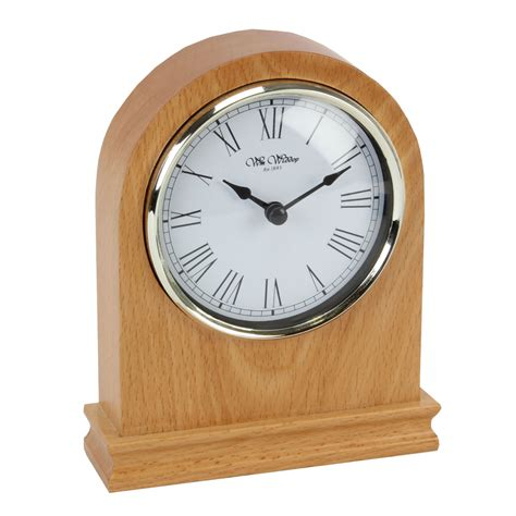 wm widdop arched light wood mantel clock
