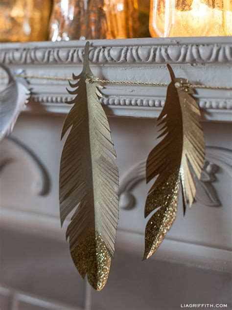 Feathers Out Of Paper - diy paper feather garland and tree ornaments