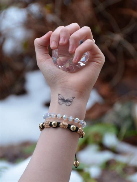 little butterfly upon my wrist raindrops of sapphire