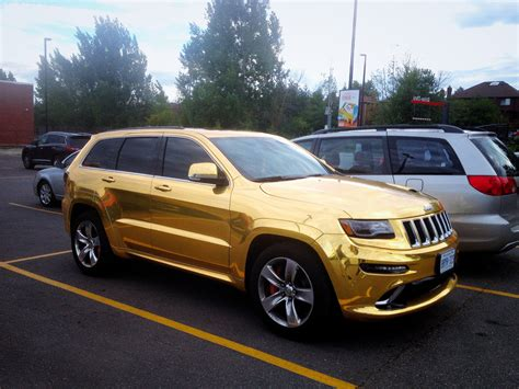 gold jeep gold wrapped jeep grand cherokee