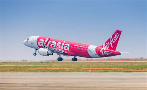 airasia online shop he tried to force open plane exit mid air sent for mental