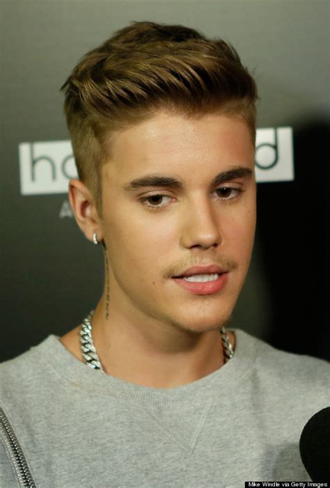 hair styles for male 15 year old justin bieber s attempt at facial hair is creeping us out