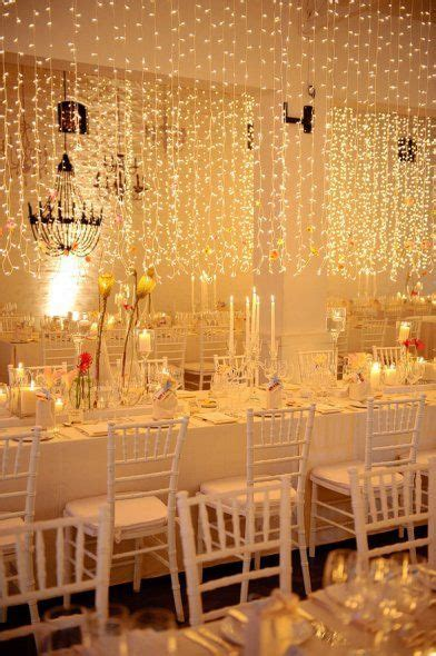 Gold lighting on white decor. Venue: MolenVliet Wine and