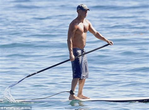 kenny chesney boat video kenny chesney reveals physique while paddleboarding with