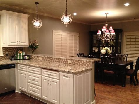sherwin williams universal khaki white cabinets walker zanger ashbury vibe tile kitchen