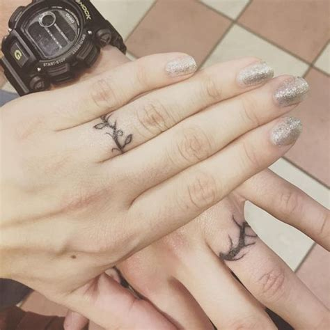 tattoo engagement rings are all the rage and we re not