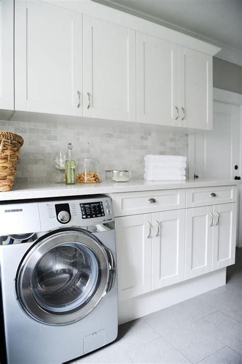 white laundry room cabinets gray laundry room features white shaker cabinets paired