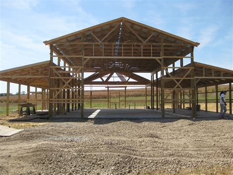 strikking pole building framing with wooden materials as inspiring pole barn homes building