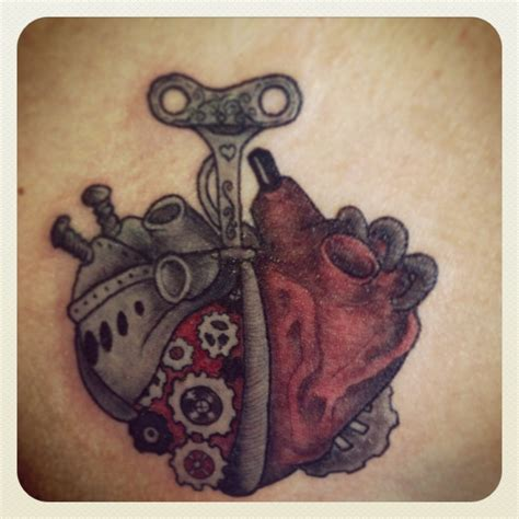 mechanical heart tattoo bio mechanical steunk style