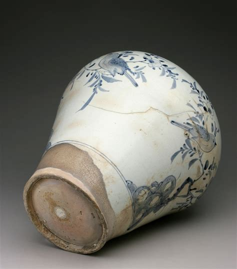 vase with design of birds plum blossoms and rocks