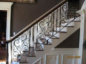 pretty swirly wrought iron stair railing for the home