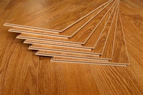 pros and cons of laminate flooring versus hardwood simple