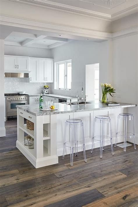 backless acrylic stools sit  front   white kitchen