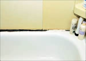 removing caulk from bathtub black stuff growing on bathtub and caulk doityourself