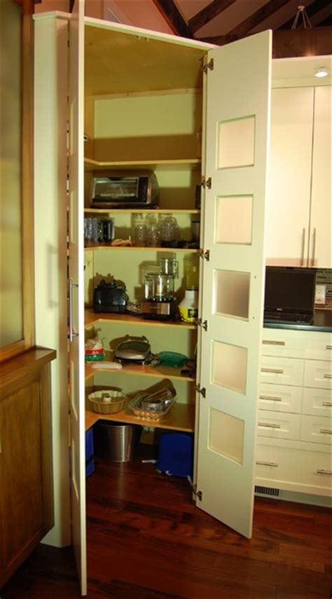corner walk in pantry within the cabinetry