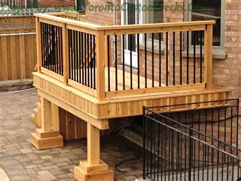 Patio Railings Designs Gallery Of A Small Cedar Deck With Wrought Iron Railings In Toronto