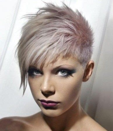 piecey pixie haircut grey crop cut with long side swept piecey bangs hairstyle