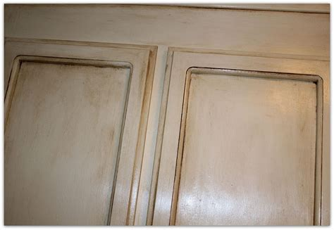 painting over painted kitchen cabinets painting over oak cabinets without sanding or priming