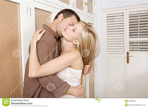 bedroom kissing couple hugging and kissing in bedroom stock photo image