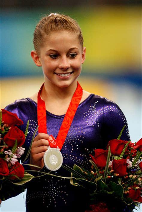 ashley johnson photos shawn gymnast poses